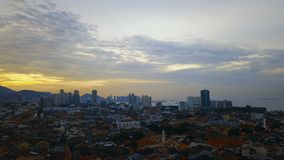 Red tile roofs in historical part of Georgetown City and Komtar Tower on Penang Island, Malaysia, at Sunset. Aerial View stock video