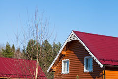 Red tile roofs of new wooden houses Royalty Free Stock Photos