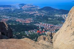 Red-tile roofs shaded in trees among blue sea and clear sky 2. Red-tile roofs shaded in trees are a scenic feature of Qingdao city , China . the city lies on Stock Photography