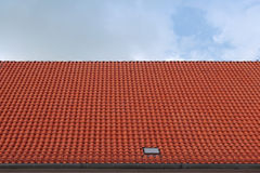 Red tile rooftop against blue sky Royalty Free Stock Photography