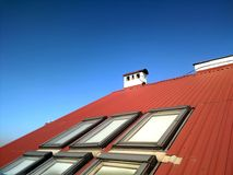 Red tiled house roof with attic windows. Roofing construction, window installation, modern architecture concept stock photos