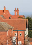 Red tiled house rooftops Stock Images