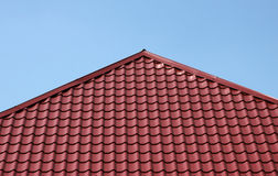 Red tiled roof. Over blue sky Stock Photography