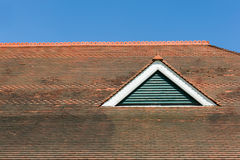 Red tiled roof. Against blue sky Stock Images