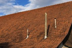 Red tiled roof with chimneys Royalty Free Stock Photos