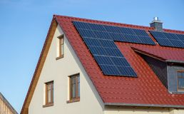 Red tiled roof of a new house with solar panels or photovoltaic power plant. Red tiled roof new house solar panels photovoltaic power plant building energy stock image