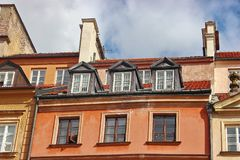 Red-tiled roof with skylights in the old town. protection of the house from precipitation. beautiful decor of the old royalty free stock photos