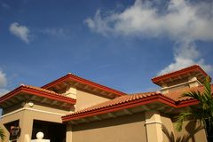 Red tiled roofs. Against bright blue sky and Stock Photography