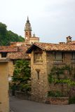 Red tiled roofs and an ancient church. In Carona, Ticino, Switzerland Royalty Free Stock Images