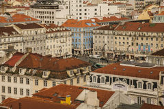 Red-tiled roofs and buildings of Lisbon, Portugal. Red-tiled roofs in Lisbon, Portugal. Old and traditional buildings of the old town in Lisbon with a blue Stock Photo