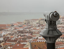 Red-tiled roofs of Lisbon, viewing point. An image of some red-tiled roofs of Lisbon. There`s the 25 de Abril Bridge visible in the background and a telescope Stock Photography