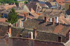 Red tiled roofs in medieval European town. Aerial view of red tiled roofs in medieval European town in Hungary Stock Image