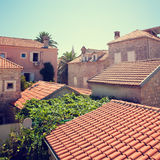 Red Tiled Roofs of Medieval Mediterranean Town Stock Photo