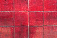 Red Tiles. Old glazed Red tile background Royalty Free Stock Image