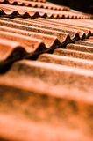 Red tiles. The roof with red tiles and chimney royalty free stock photography