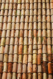 Red tiles pattern on traditional roof. Vertical shot Royalty Free Stock Image