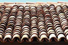 Red tiles roof background. Background of old roof tiles. Royalty Free Stock Images