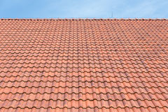 Red tiles roof background and blue sky Stock Photography