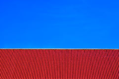 Red tiles  roof on clear blue sky background Stock Photo