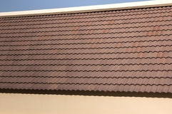 Red tiles on roof house. Red tiles on roof construction house Royalty Free Stock Image