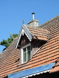 Red tiles roof and window Royalty Free Stock Photography
