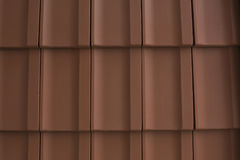 Red tiles of shingles on the roof Royalty Free Stock Photo