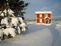 Red timber house winter christmas background Royalty Free Stock Photo