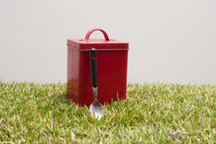 Red tin and spoon Royalty Free Stock Photo