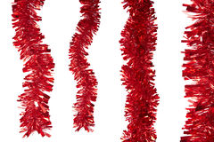 Red tinsel. Isolated on white Royalty Free Stock Photos