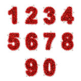 Red tinsel digits with star on white Royalty Free Stock Photography