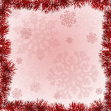 Red tinsel frame on snowflake background Stock Image