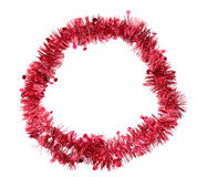 Red tinsel round border, frame, on white background. Stock Image