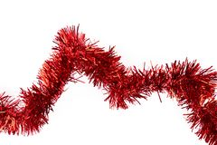 Red tinsel on white background. Stock Image