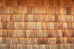 Red tinted wooden tiles. Wall of red tinted wooden tiles Stock Image