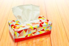 Red Tissue box blank label and no text for mock up packaging on wood desktop. Backgrounds stock photography