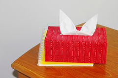 Red tissue paper box on wooden table Stock Images