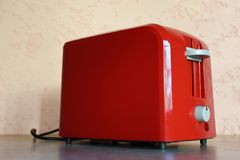 Red toaster on grey stock photography