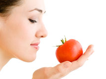 Red tomato. A girl with a ripe red tomato Royalty Free Stock Images