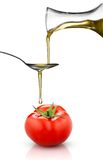 Red Tomato And Pouring Oil Isolated On White Stock Images