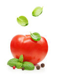 Red tomato and basil leaves spice falling down Royalty Free Stock Photo