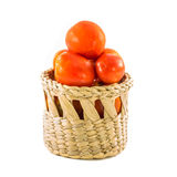 Red tomato in basket isolated on white Stock Image