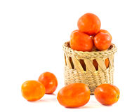 Red tomato in basket isolated on white Stock Photo