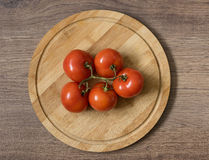 Red tomato bunch Stock Images