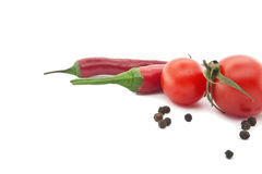 Red tomato and chili pepper. Vegetables for mexican food. Isolated on a white background. Selective focus Royalty Free Stock Photos