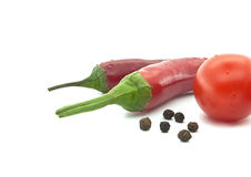 Red tomato and chili pepper. Vegetables for mexican food. Isolated on a white background. Selective focus Stock Photos
