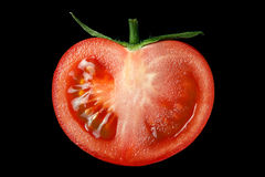 The red tomato cut half-and-half. Stock Photos