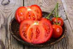 Red tomato, cut in half Royalty Free Stock Image