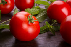 Red tomato on a dark board Royalty Free Stock Photos