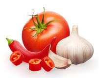 Red tomato, garlic with clove and cut chili pepper vegetables Royalty Free Stock Image