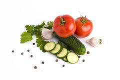Red tomato garlic and cucumber on a white background Fresh vegetables on a white background. cucumber and tomato on a white backgr Royalty Free Stock Image